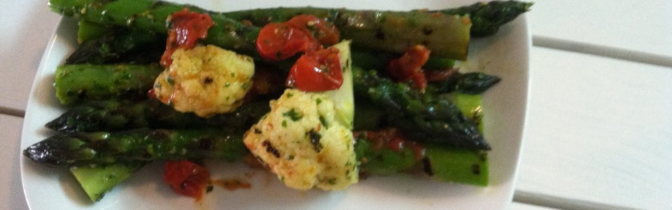 Grilled asparagus and cauliflower with roasted cherry tomatoes and fresh basil oil
